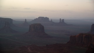 AX133_181 - 6K stock footage aerial video of a wide view of Merrick Butte and nearby buttes in Monument Valley, Utah, Arizona, sunset