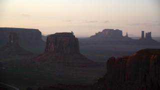 AX133_193 - 6K stock footage aerial video flyby Merrick Butte, reveal Elephant Butte in Monument Valley, Utah, Arizona, sunset