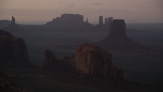 AX133_213 - 6K stock footage aerial video of flying by Camel Butte, East Mitten Butte in Monument Valley, Utah, Arizona, twilight