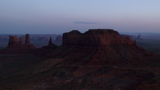 AX134_016 - 6K stock footage aerial video of passing by buttes in Monument Valley, Utah, Arizona, twilight
