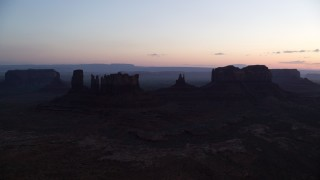 AX134_021 - 6K stock footage aerial video of buttes in Monument Valley, Utah, Arizona, at twilight