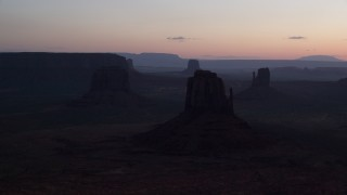 AX134_029 - 6K stock footage aerial video of flying by several buttes in Monument Valley, Utah, Arizona, twilight