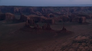 AX134_036 - 6K stock footage aerial video of buttes and rock formations in Monument Valley, Utah, Arizona, twilight