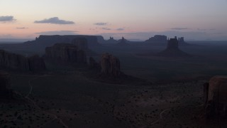 AX134_040 - 6K stock footage aerial video a view of desert buttes and mesas at twilight in Monument Valley, Utah, Arizona