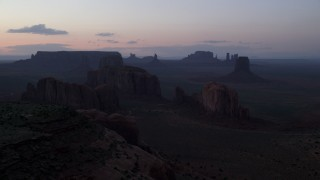 AX134_041 - 6K stock footage aerial video of desert buttes and mesas in famous Monument Valley, Utah, Arizona, twilight