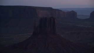 AX134_061 - 6K stock footage aerial video of West Mitten Butte in Monument Valley, Utah, Arizona, twilight