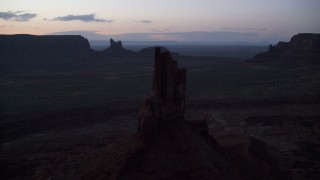 AX134_063 - 6K stock footage aerial video of passing by Big Indian Butte in Monument Valley, Utah, Arizona, twilight