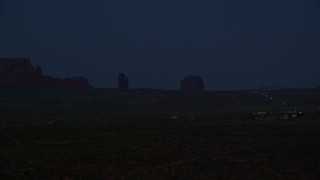 AX134_074 - 6K stock footage aerial video of West Mitten Butte, Merrick Butte in Monument Valley, Utah, night