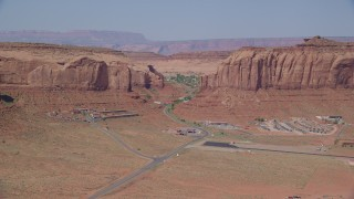 AX135_003 - 6K stock footage aerial video flyby Goulding's Lodge, Oljeto Mesa by Monument Valley Airport, Utah