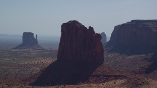 AX135_010 - 6K stock footage aerial video of flying by Gray Whiskers Butte and West Mitten Butte, Monument Valley, Utah, Arizona