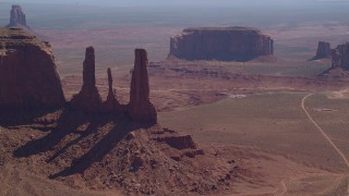 AX135_017 - 6K stock footage aerial video of the Three Sisters buttes in Monument Valley, Utah, Arizona