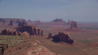 AX135_022 - 6K stock footage aerial video flyby Elephant Butte, Cly Butte, East Mitten Butte in Monument Valley, Utah, Arizona