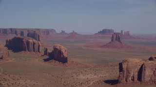 AX135_023 - 6K stock footage aerial video wide view of buttes, seen from Spearhead Mesa in Monument Valley, Utah, Arizona