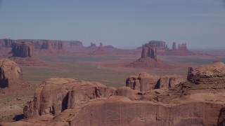 AX135_024 - 6K stock footage aerial video of East Mitten Butte and other distant buttes in Monument Valley, Utah, Arizona