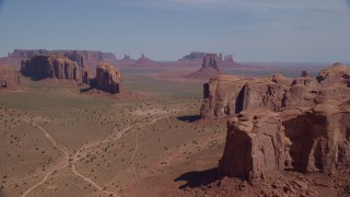 AX135_028 - 6K stock footage aerial video approach buttes from Spearhead Mesa, Monument Valley, Utah, Arizona