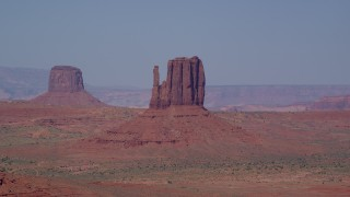 AX135_039 - 6K stock footage aerial video flyby Mitchell Butte and West Mitten Butte in Monument Valley, Utah, Arizona