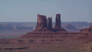 AX135_065 - 6K stock footage aerial video of a group of desert buttes in Monument Valley, Utah, Arizona