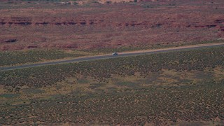 AX135_069 - 6K stock footage aerial video of tracking car stopped on Highway 163, Monument Valley, Utah, Arizona