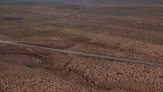 AX135_073 - 6K stock footage aerial video of flying by Highway 163, revealing Forest Gump Point, Monument Valley, Utah, Arizona