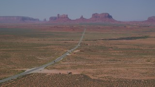 AX135_075 - 6K stock footage aerial video of approaching Forrest Gump Point and Highway 163, Monument Valley, Utah, Arizona