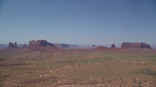AX135_092 - 6K stock footage aerial video of several desert buttes and mesas in famous Monument Valley, Utah, Arizona