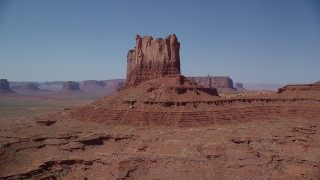 AX135_109 - 6K stock footage aerial video approach and flyby Stagecoach Butte in Monument Valley, Utah, Arizona