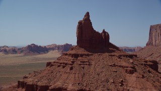 AX135_127 - 6K stock footage aerial video of orbiting Rooster Rock in Monument Valley, Utah, Arizona