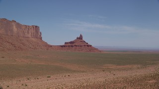 AX135_133 - 6K stock footage aerial video descend and approach Rooster Rock, Monument Valley, Utah, Arizona