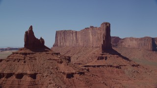 AX135_138 - 6K stock footage aerial video of passing by Rooster Rock and Meridian Butte, Monument Valley, Utah, Arizona
