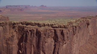 AX135_143 - 6K stock footage aerial video of flying by the top of Meridian Butte, Monument Valley, Utah, Arizona