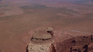 AX135_147 - 6K stock footage aerial video of flying over Meridian Butte, pan to reveal Rooster Rock butte, Monument Valley, Utah, Arizona