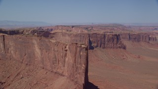 AX135_149 - 6K stock footage aerial video of approaching Meridian Butte in a desert valley, Monument Valley, Utah, Arizona