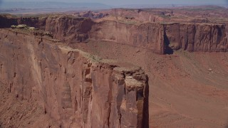 AX135_150 - 6K stock footage aerial video of approaching Meridian Butte, tilt to top of the butte, Monument Valley, Utah, Arizona
