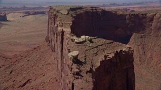 AX135_151 - 6K stock footage aerial video of flying over top over Meridian Butte in Monument Valley, Utah, Arizona