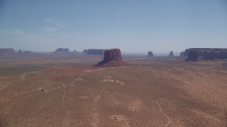 AX135_194 - 6K stock footage aerial video of a wide view of open desert, mesas and buttes, Monument Valley, Arizona, Utah