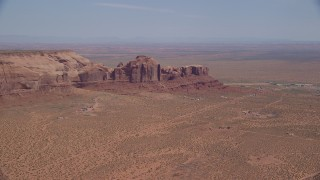 AX135_196 - 6K stock footage aerial video of Rock Door Mesa and town of Goulding, Navajo Nation Reservation, Utah, Arizona