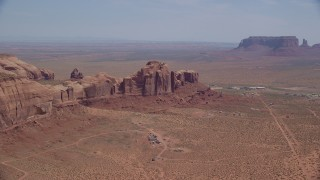 AX135_197 - 6K stock footage aerial video of passing town of Goulding by Rock Door Mesa, Navajo Nation Reservation, Utah, Arizona