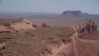 AX135_198 - 6K stock footage aerial video of Rock Door Mesa at Navajo Nation Reservation, Utah, Arizona