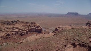 AX135_200 - 6K stock footage aerial video of Goulding by Rock Door Mesa and Oljeto Mesa, Navajo Nation Reservation, Utah, Arizona