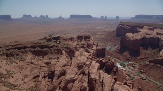 AX135_202 - 6K stock footage aerial video of Monument Valley seen from Oljeto Mesa, Navajo Nation Reservation, Utah, Arizona