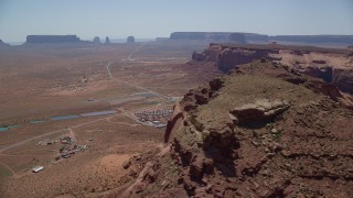 AX135_203 - 6K stock footage aerial video of flying by Oljeto Mesa, revealing the Monument Valley Airport, Utah