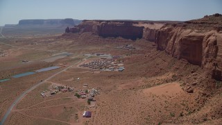AX135_204 - 6K stock footage aerial video of flying by Goulding's Lodge, near Oljeto Mesa and Monument Valley Airport, Utah