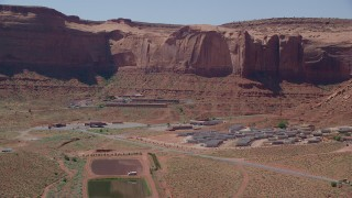 AX135_205 - 6K stock footage aerial video of flying by Goulding's Lodge at the base of Rock Door Mesa, Goulding, Utah