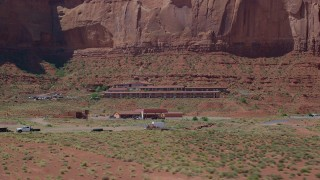 AX135_206 - 6K stock footage aerial video of flying low by Goulding's Lodge and Goulding's Store, Goulding, Utah