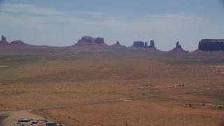 AX136_003 - 6K stock footage aerial video of flying by highway, buttes and Monument Valley Road, Arizona, Utah