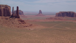 AX136_017 - 6K stock footage aerial video of buttes in a desert valley, Monument Valley, Utah, Arizona