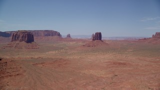 AX136_033 - 6K stock footage aerial video of a wide view of a few desert buttes and mesas, Monument Valley, Utah, Arizona