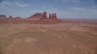 AX136_034 - 6K stock footage aerial video of approaching jagged desert buttes in Monument Valley, Utah, Arizona