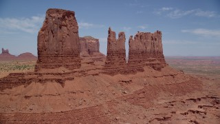 AX136_037 - 6K stock footage aerial video of approaching towering desert buttes in Monument Valley, Utah, Arizona