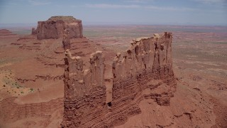 AX136_038 - 6K stock footage aerial video of approaching tops of desert buttes, Monument Valley, Utah, Arizona